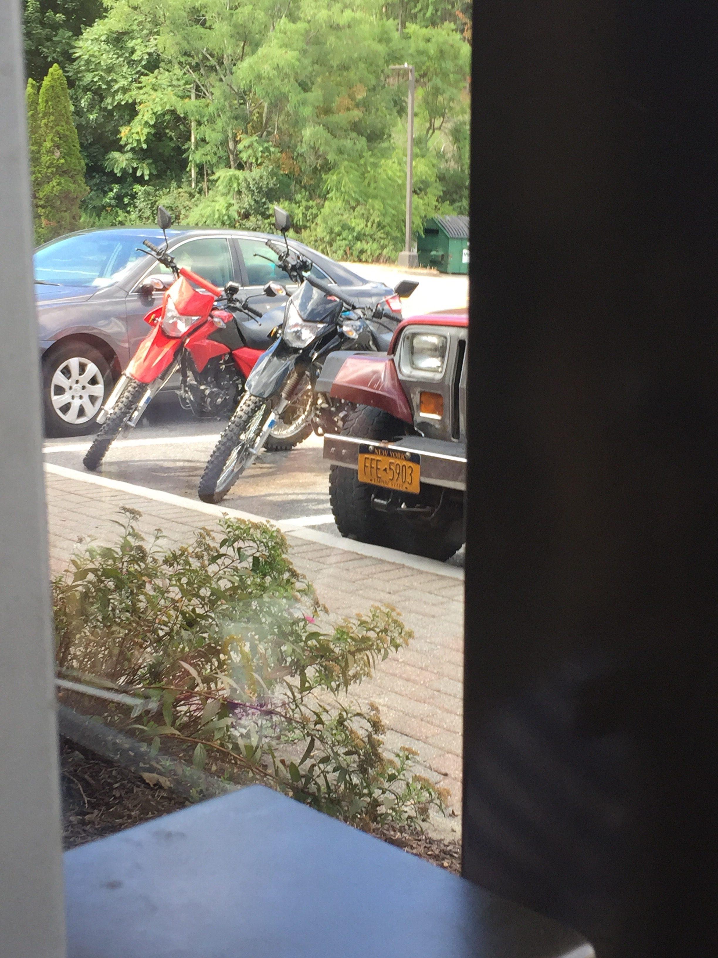 2 Hawk 250 Bikes in Parking Lot
